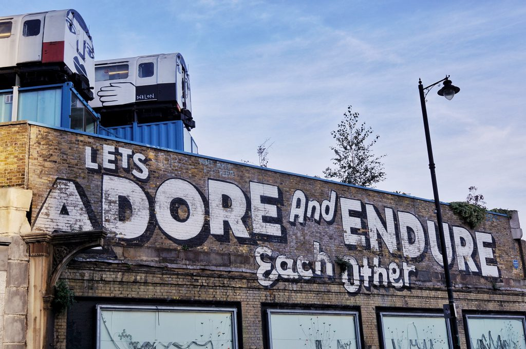 Shoreditch-street-art-lets-adore-and-endure-each-other